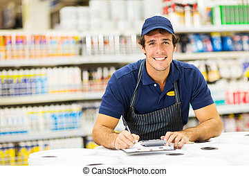 male hardware store worker - handsome young male hardware...