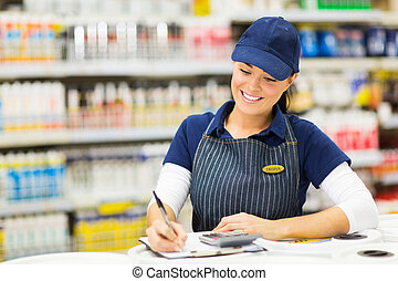 store clerk writing stock - beautiful store clerk writing...