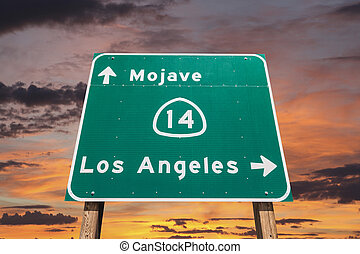 Mojave Desert Freeway Sign to Los Angeles with Sunset Sky -...