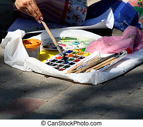 Palette of the artist - The artist types a paint on a brush...