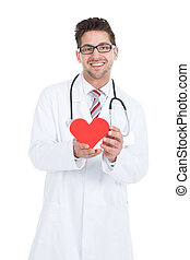 Confident Young Male Doctor Holding Heart - Portrait of...