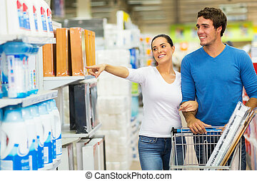 couple shopping at hypermarket - smiling couple shopping at...