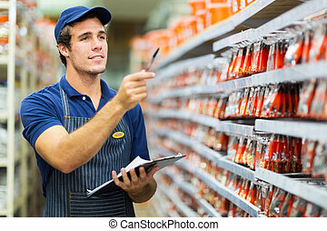 hardware store worker counting stock - good looking hardware...