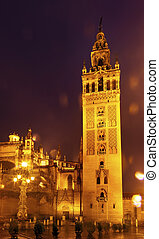 Giralda Bell Tower Seville Cathedral Rainy Night Car Trails...