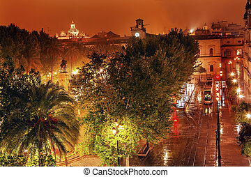 Plaza Nueva Ferdinand Statue Train Rainy Night Seville Spain...