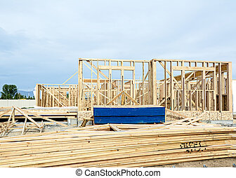 Wooden studs erected in home construction - New construction...