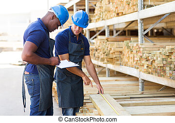 hardware store workers working in timber warehouse