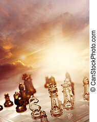 Chess - Game of chess pieces in front of bright sky