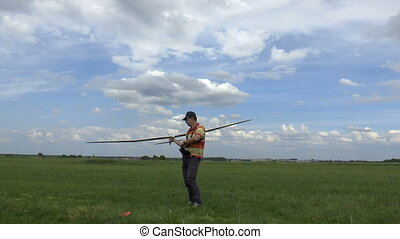Man Launches RC Glider in the Sky, on blue sky background