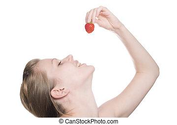 beautiful girl eating a strawberry - beautiful blonde girl...