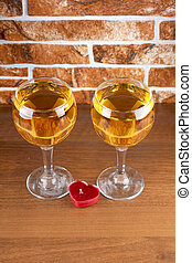 Wineglass on stone - Wine bottle and glass on brick wall...