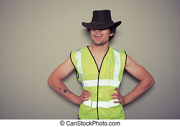 Cowboy builder wearing a high visibility vest - A cheeky...