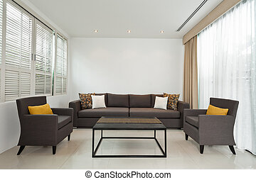 Bright Living room with grey sofa and minimalistic...