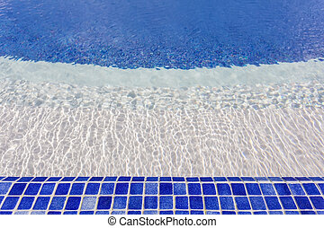 Mosaic tiles in the pool with water. The hotel for swimming and recreation.