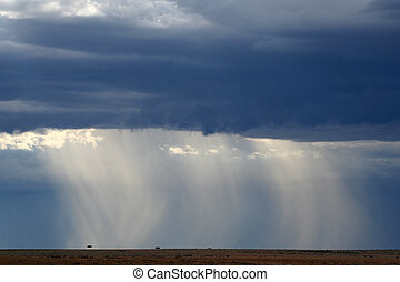 Rain Season Africa - Rainclouds over plains of Masai Mara