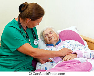 Elderly care - Caregiver with an elderly patient at home