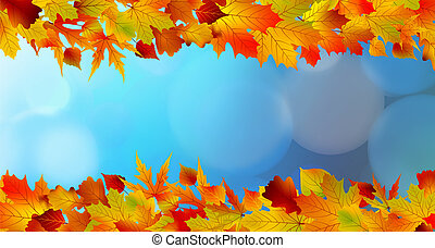 Red and yellow leaves against a bright blue sky