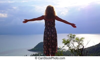 Happy Woman Rising Hands on the Top of Mountain Slow Motion...