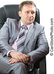 Portrait of a handsome young boss, isolated on white...
