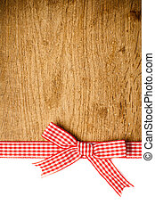 Wooden background with a red checkered ribbon