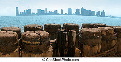 Jersey City viewed from Manhattan, wooden pier in foreground