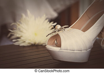 bridal shoes - a pair of wedding shoes on wooden table with...