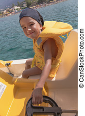 the child on the catamaran - small European boy manages...