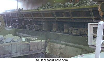 Railway Car pours stones Unloading of trains
