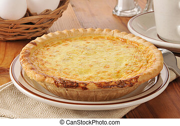 Quiche Lorraine in an individual size, with a basket of eggs...