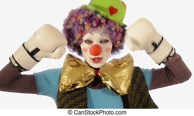 boxing clown - a bumbling clown with boxing gloves over...