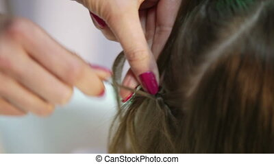 Weaving braids child - Hairdresser pigtail braids young girl