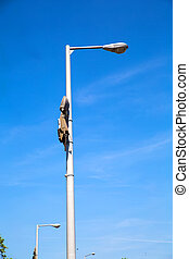 Street light - A street light against a blue sky.