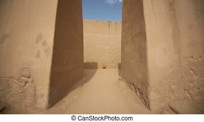 The Entrance with big walls of the Huaca Arco Iris in...