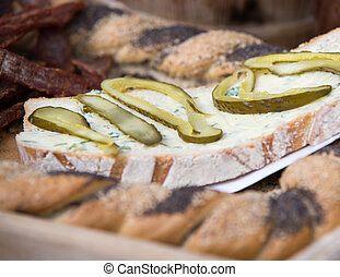 slice of bread with garlic butter and cucumber