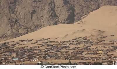Slum in the desert in Trujillo in Peru - Video footage of...