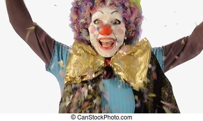 the clown and the carnival - Nice clown throwing confetti on...