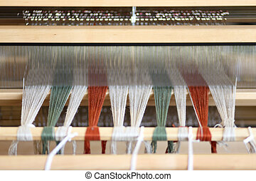 Foot-treadle floor loom with threads.