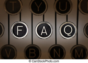 Old Style FAQ - Close up of old manual typewriter keyboard...
