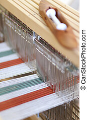 Foot-treadle floor loom with threads