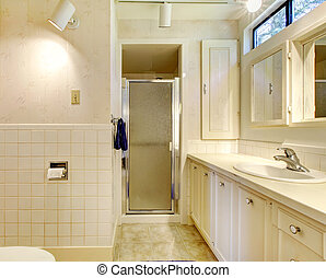 White bathroom with old cabinets