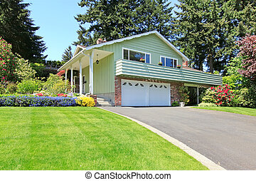 House with brick wall trim and garage - Mint house with...