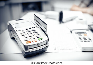 Bank terminal and payment card on the office table