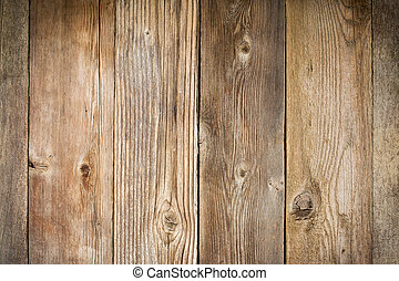 rustic weathered wood background with grain and knots...