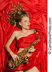 Woman with golden saxophone