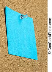 Blank sheet of blue paper on a bulletin board