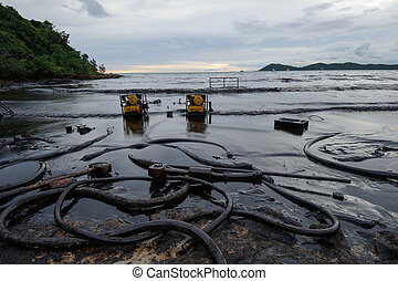 crude oil on oil spill accident on Ao Prao Beach at Samet...