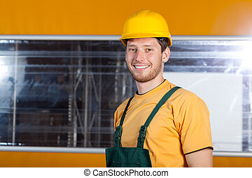 Factory worker in overalls and hardhat