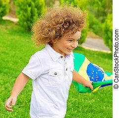Happy little football fan - Portrait of cute little boy...