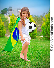 Happy little football player - Happy cheerful girl playing...
