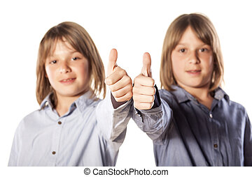 Twin brothers - two twin brothers showing thumbs up
